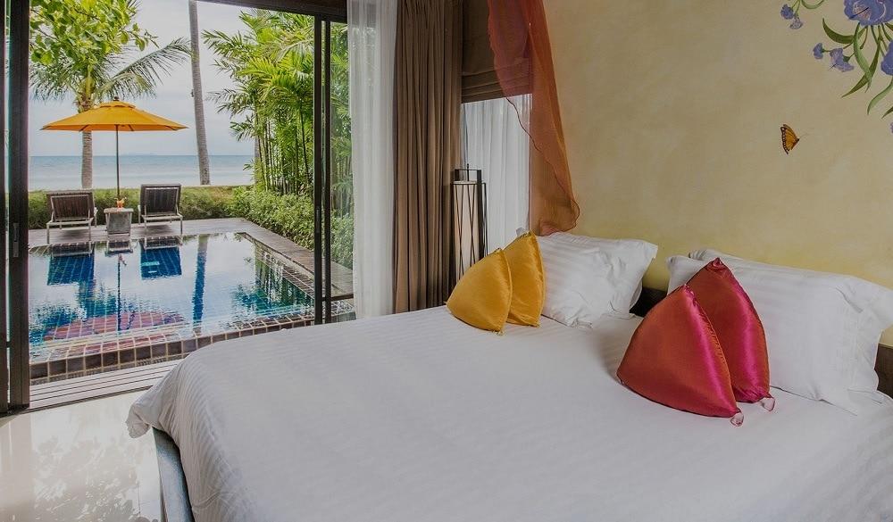 The Passage Samui Villas & Resort bedroom with pool