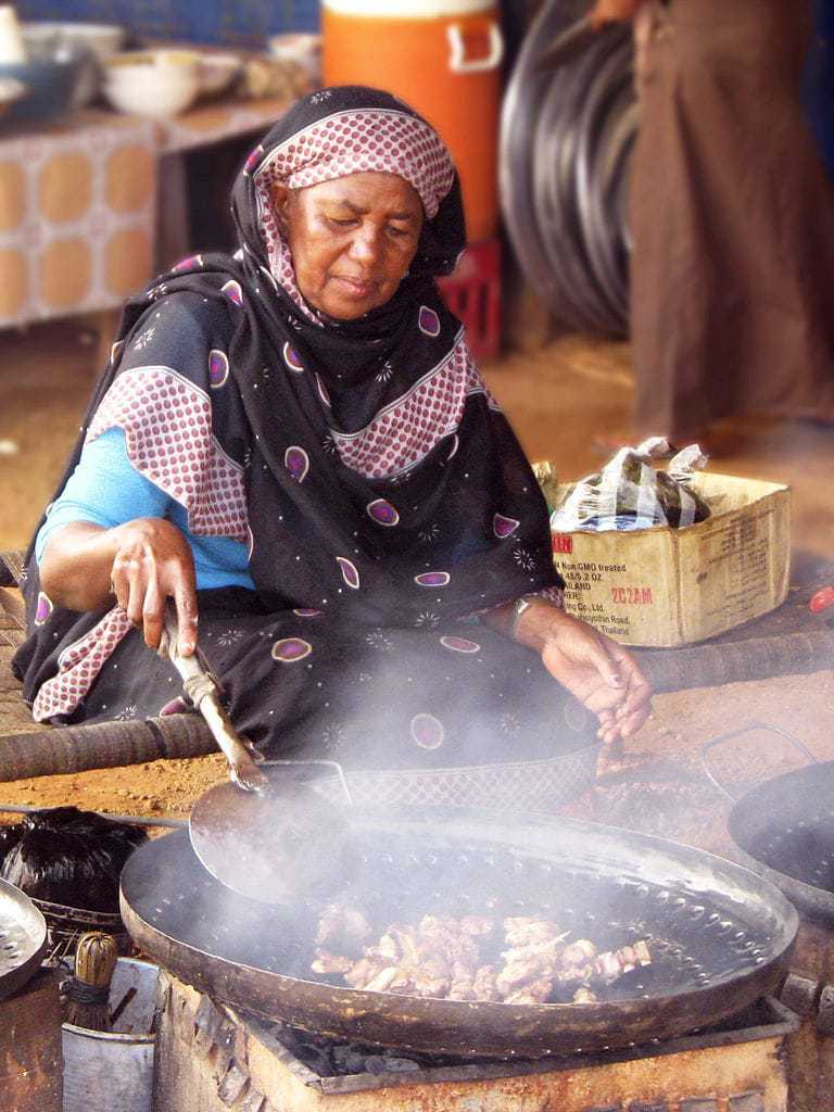 A woman cooking food in Sudan