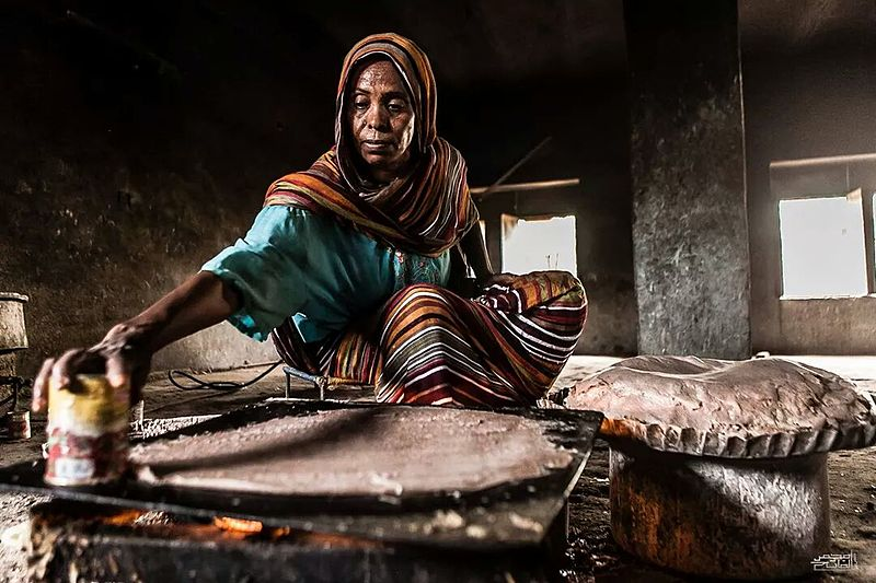 Woman making Kisra bread from Sudan