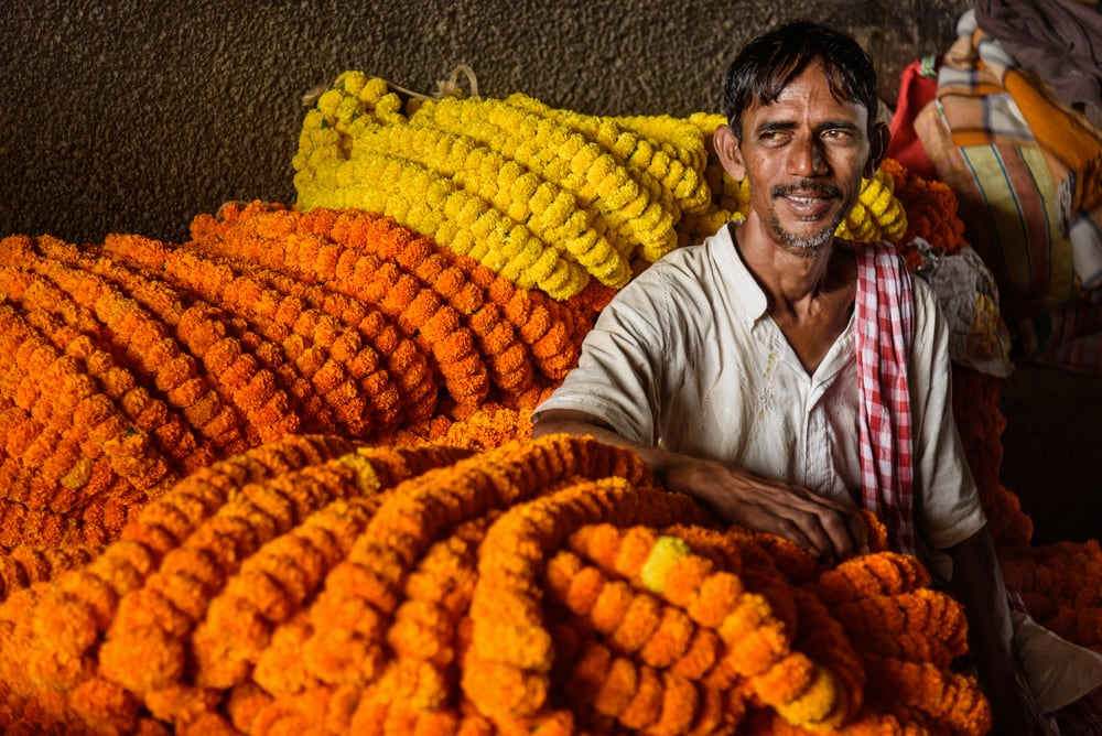 Indian seller at Mallick Ghat Flower Market